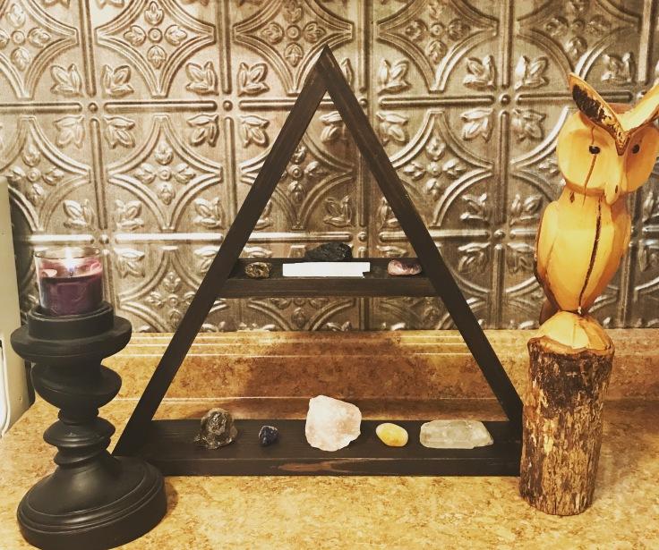 crystals on triangle shelf.JPG